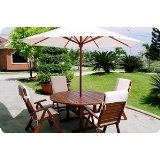 Six piece wooden patio dining set with white umbrella on patio, wooden outdoor furniture, outdoor furniture resource..